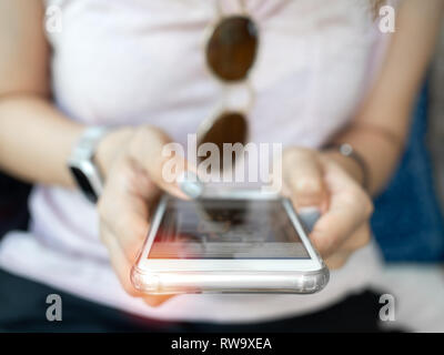 Close-up woman's hand using smartphone. Human with technology concept. - Stock Photo