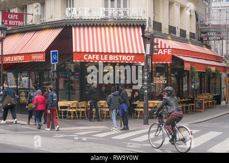 Paris street scene on Boulevard Magenta, in front of the cafe Le Bistrot, in the 10th arrondissement. France. - Stock Photo