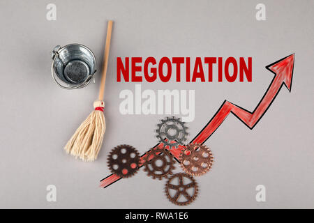 Negotiation concept. Gears, bucket with a broom - Stock Photo