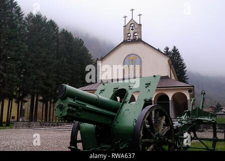 Timau, Carnic Alps, Italy. In the Timau ossuary there are the remains of numerous soldiers dead on the Carnian front during the first world war. They are 1763 fallen, 298 unknown Italians plus 65 Austro-Hungarians coming from small mountain cemeteries. The ossuary was built between 1936 and 1939 at the behest of the priest Don Titta Bulfon. - Stock Photo