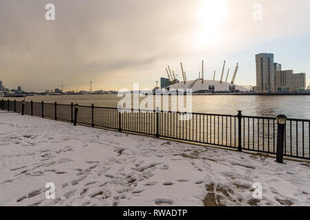 The O2 Arena seen from East India across the river Thames on a freezing winter day, covered in fresh white snow brought by the 'Beast from the East' - Stock Photo