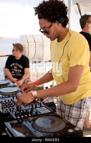 DJ Hutch playing on a boart party at Hideout Festival by day, Croatia - Stock Photo