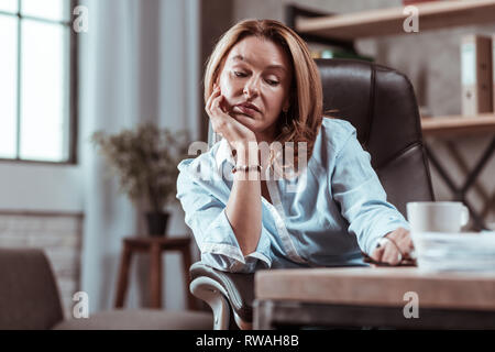Woman wearing stylish accessories feeling sad and tired