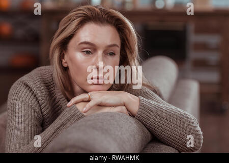 Appealing businesswoman feeling thoughtful and very concerned