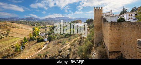 Panoramic landscape with fortress walls and beautiful countryside valley in Ronda. Andalusia, Spain - Stock Photo