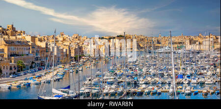 Panoramic landscape with marina in Grand Harbour against scenic background of Valletta town. Malta - Stock Photo