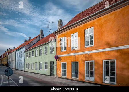 One of the many quaint little narrow streets in the old town of Helsingor in Denmark. - Stock Photo