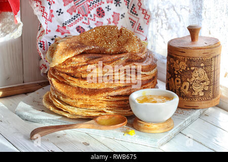 still life with pancakes and honey on a white wooden background - Stock Photo