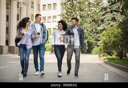 Multiethnic group of students near collage - Stock Photo