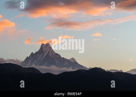 View of Mount Machapuchare (from Nepali meaning 'fishtail') from Poon Hill (3210 m) on sunrise, Annapurna Conservation Area, Himalaya, Nepal. - Stock Photo