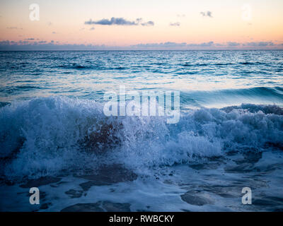 Sunlit Surf, Waves Crashing on Tropical Beach, Governors Harbour, Eleuthera, The Bahamas, The Caribbean. - Stock Photo