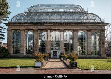 The front and entrance pathway to the Glasshouse Experience building in the Royal Botanic Garden on a sunny day, Edinburgh, Scotland - Stock Photo