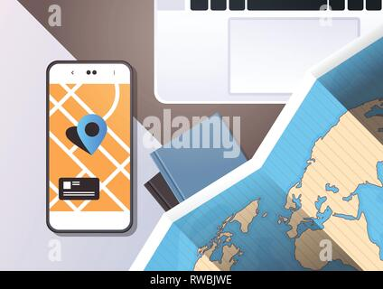 navigation online application paper world map with gps location mark top angle view workplace desktop with cell smartphone laptop office stuff - Stock Photo