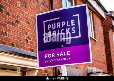 Nottingham, England, United Kingdom - 23/03/2019: estate agents purple bricks sign showing the availability of a property for sale. purple sign in for - Stock Photo
