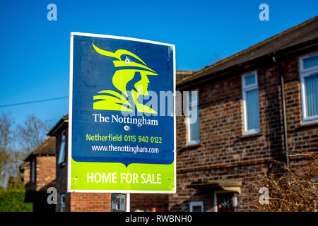 Nottingham, England, United Kingdom - 23/03/2019: estate agents The Nottingham sign showing the availability of a property for sale. Blue and Green. - Stock Photo
