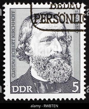 GDR - CIRCA 1974: a stamp printed in GDR shows Gustav Robert Kirchhoff, Physicist, circa 1974 - Stock Photo