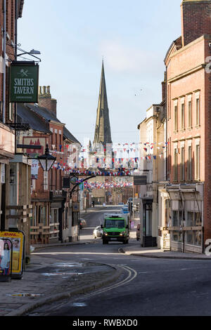 Ashbourne, UK. 5th Mar, 2019. Royal Shrovetide Football, day 1; General view of Ashbourne before the football showing shops boarded up and bunting across the streets Credit: Action Plus Sports/Alamy Live News - Stock Photo