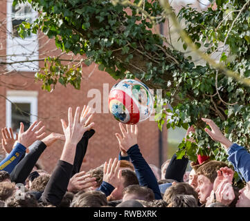 Ashbourne, Derbyshire, UK. 5th Mar, 2019. Royal Shrovetide Football, day 1; The Shrovetide Football gets loose in the air as players grapple for it Credit: Action Plus Sports/Alamy Live News - Stock Photo