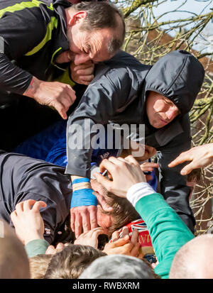 Ashbourne, Derbyshire, UK. 5th Mar, 2019. Royal Shrovetide Football, day 1; Shrovetide players try to grab the Shrovetide Football from above as players grapple for it from all sides Credit: Action Plus Sports/Alamy Live News - Stock Photo