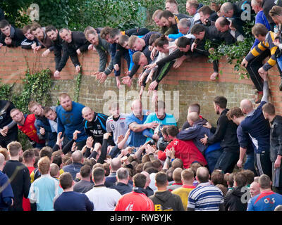 Ashbourne Derbyshire, UK. 5th Mar, 2019. Ashbourne Royal Shrovetide Football match on Shrove Tuesday. Ye Olde & Ancient Medieval hugball game is the forerunner to football. It's played between two teams, the Up'Ards & Down'Ards separated by the Henmore Brook river. The goals are 3 miles apart at Sturston Mill & Clifton Mill. Charles Cotton's poem Burlesque upon the Great Frost, dating from 1683, mentions this game at Ashbourne. He was the cousin of Aston Cockayne Baronet of Ashbourne, Derbyshire. Credit: Doug Blane/Alamy Live News - Stock Photo