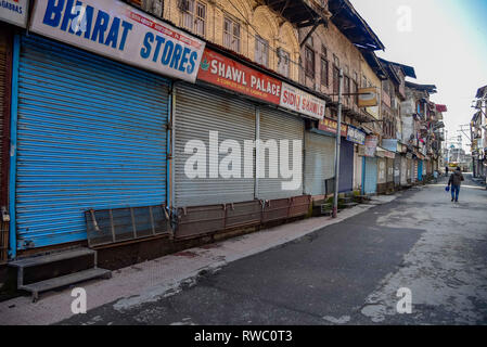 Srinagar, Jammu and Kashmir, India. 5th Mar, 2019. A Kashmiri man seen walking next to closed shops during a shut down in Srinagar.Normal life was affected in Kashmir valley and Banihal due to a strike call issued by various trade bodies against ban on Jama'at-e-Islami and assault on Article 35A. Credit: Idrees Abbas/SOPA Images/ZUMA Wire/Alamy Live News - Stock Photo
