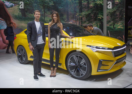 Geneva, Switzerland. 6th March, 2019. Models posing with the Skoda Vision iV car at the press days of the  88th Geneva International Motor Show. Credit: Eric Dubost/Alamy Live News - Stock Photo