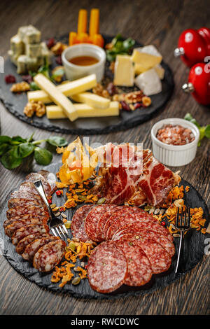 Food tray with delicious salami, pieces of sliced ham and sausage - Stock Photo