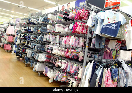 09485f9c A variety of Children's clothing on sale in a Tesco store - Stock Photo