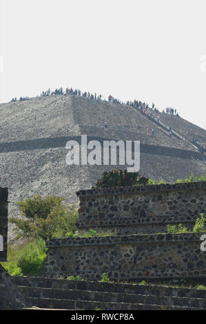 Tourists on top of Pyramid of the Sun overseeing Teotihuacan, Mexico - Stock Photo