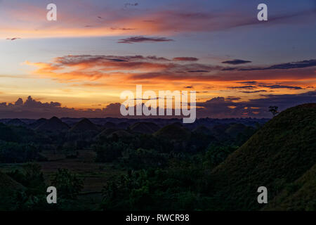 Bohol Island, Philippines. April, 2018. General view in sunset light of the National Geological Monument of the Chocolate Hills at Bohol Island - Stock Photo