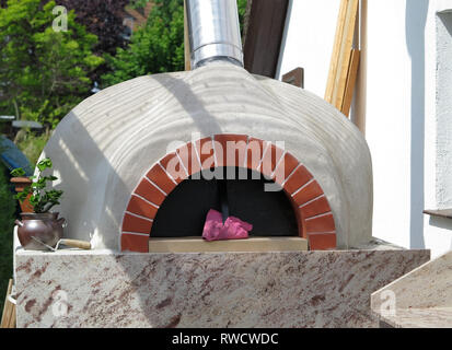 Outdoor wood fired pizza oven - Stock Photo