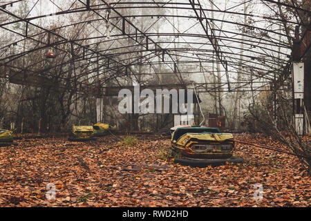 Bumper cars abandoned quickly during the Chernobyl nuclear evacuation - Stock Photo