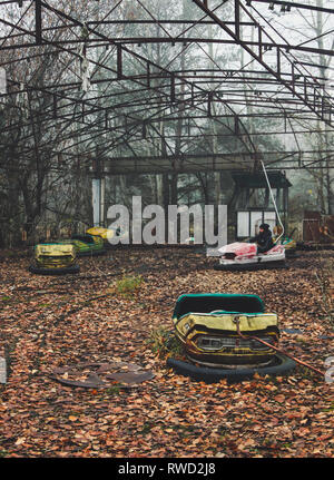 Bumper cars abandoned quickly during the Chernobyl nuclear evacuation. - Stock Photo