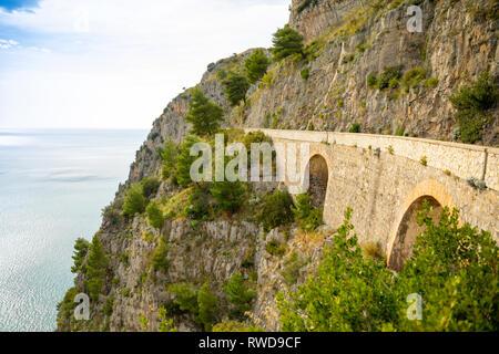 Mountain road with sea view near Maratea, Basilicata, Italy - Stock Photo