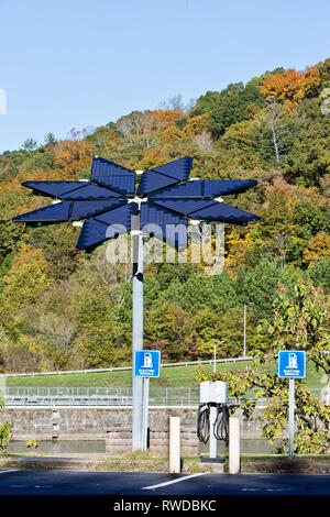 Electric Vehicle Charge Station, Solar Array Panels, identified as 'Solar Voltaic Flair',  17 ft. in diameter, weighing approx. 1200 lbs. - Stock Photo