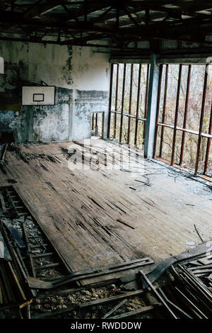 Abandoned basketball court left to rot with time inside Chernobyl's exclusion zone - Stock Photo
