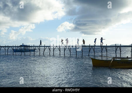 Dancing and Playing Children on Island Pier, General Luna -Siargao, Philippines - Stock Photo