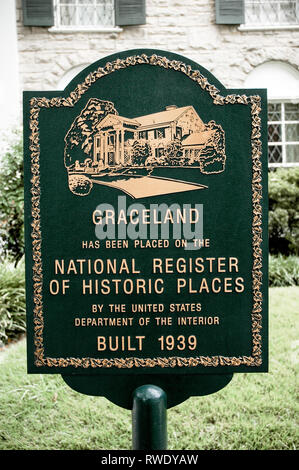 MEMPHIS, TN, USA: OCTOBER 11, 2006: A sign stands in front of Elvis Presley's Graceland, designating the home as a historic place. - Stock Photo