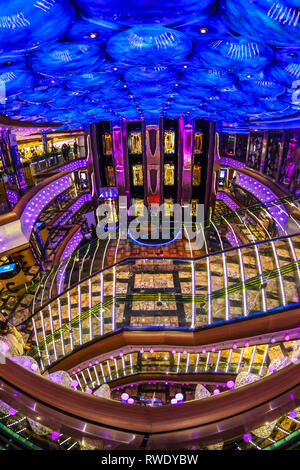 Main hall of a classy and elegant brand new cruise ship, view from the upper deck with a wide-angle lens - Stock Photo