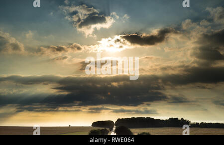 Sunset over receding Country Road in Rural England - Stock Photo