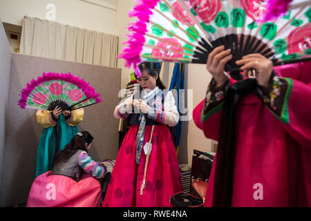 North and South Korean Ladies perform the Buchaechum also called a Fan Dance on the day Korea Commemorates 100th Anniversary of March 1st Independence. - Stock Photo