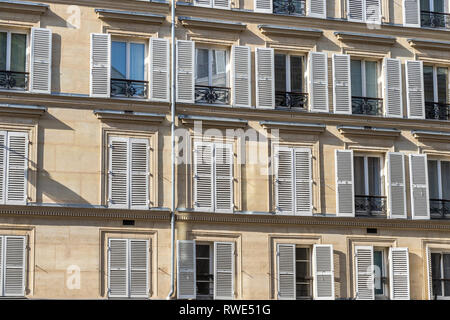 Paris apartments with wooden shutters on the windows in the sunshine ,Rue Notre Dame de Lorette,St Georges in the 9th arrondissement of Paris - Stock Photo