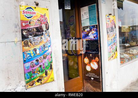 A Sanson poster outside of a local shop in Italy - Stock Photo