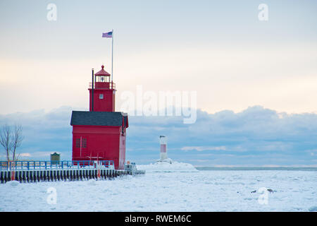 Big Red lighthouse in Holland Harbor channel in winter Stock Photo