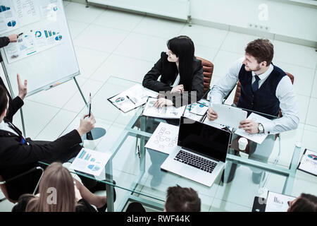 members of a business team discussing the presentation of a new financial project - Stock Photo