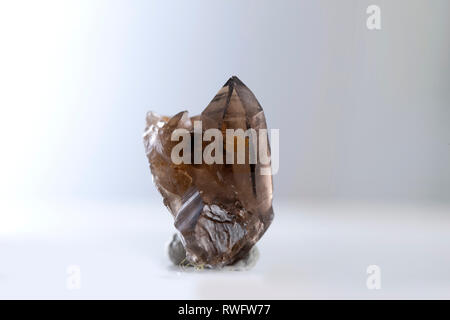 smoky crystal mineral stone quartz gem rock geology - Stock Photo