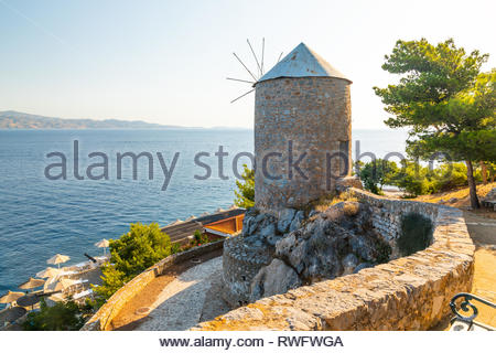 Traditional Greek Mill on Hydra island, Greece. - Stock Photo