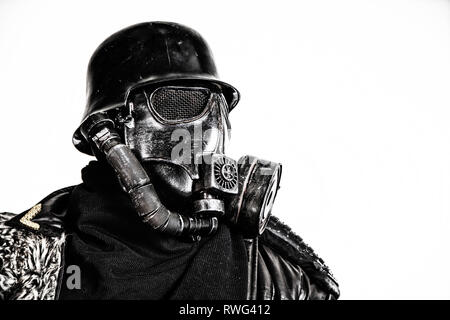 Close-up portrait of a futuristic Nazi soldier wearing gas mask. - Stock Photo