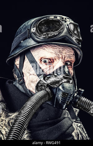 Ugly burnt face of futuristic Nazi soldier wearing gas mask. - Stock Photo