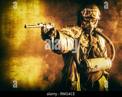 Futuristic Nazi soldier with Luger pistol and gas mask, in fire and smoke. - Stock Photo